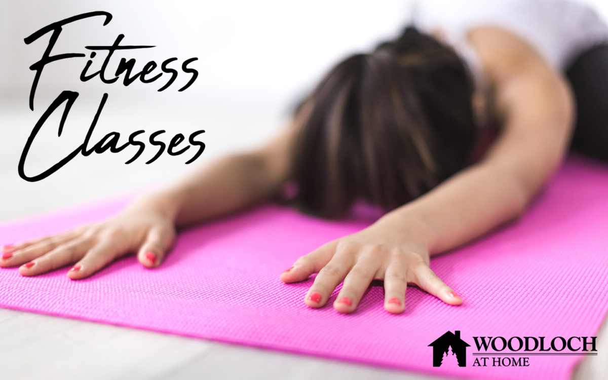 Woman doing yoga stretch on a mat. Text: Fitness Classes, Woodloch at Home.