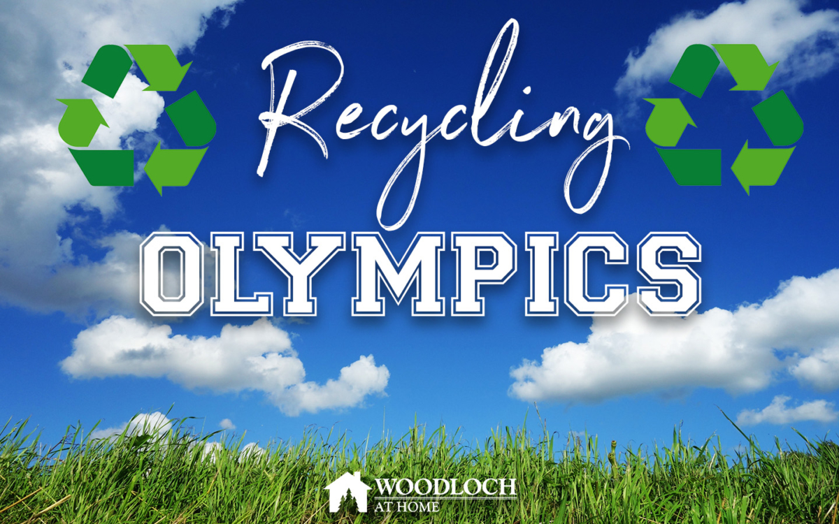 Grass and blue skies. Text: Recycling Olympics, Woodloch at Home.