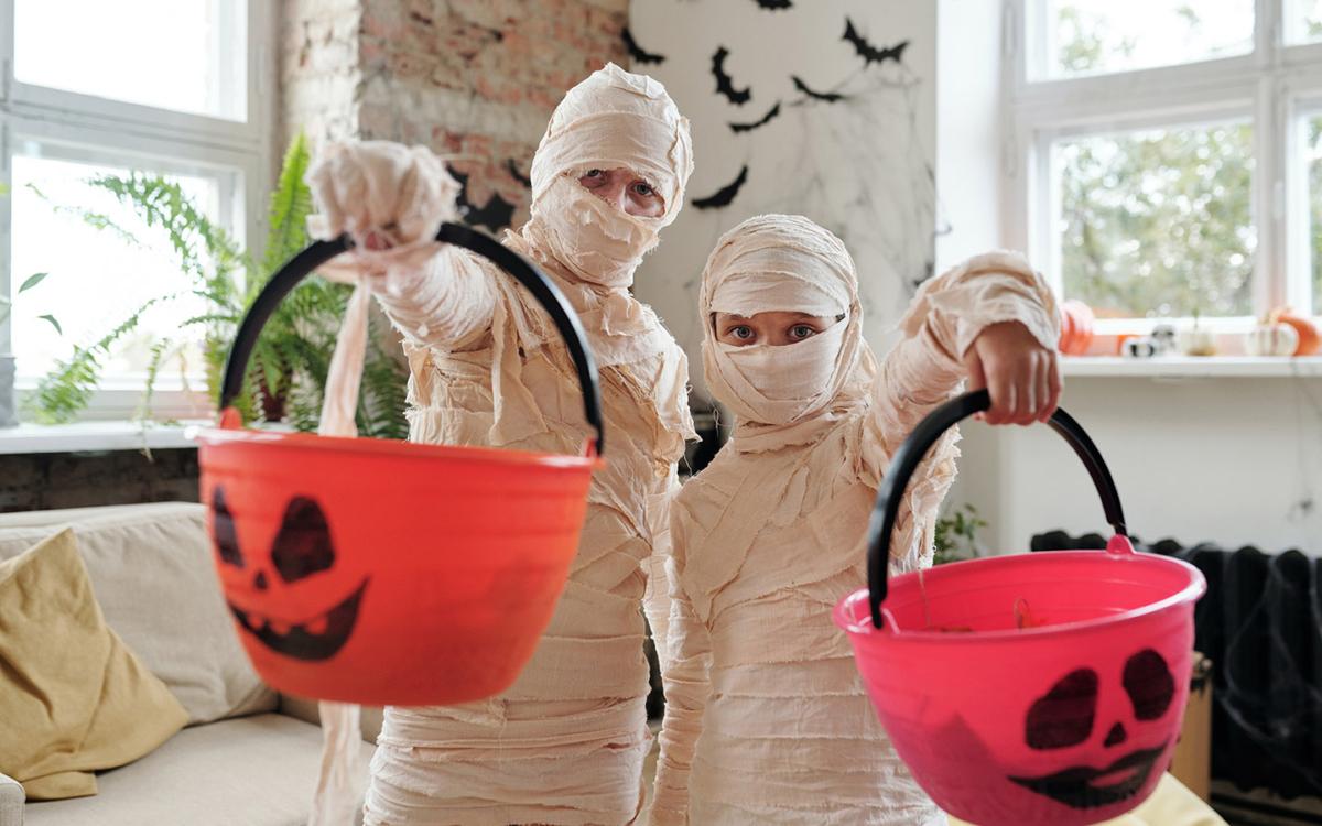 Mummies with Halloween treat baskets.