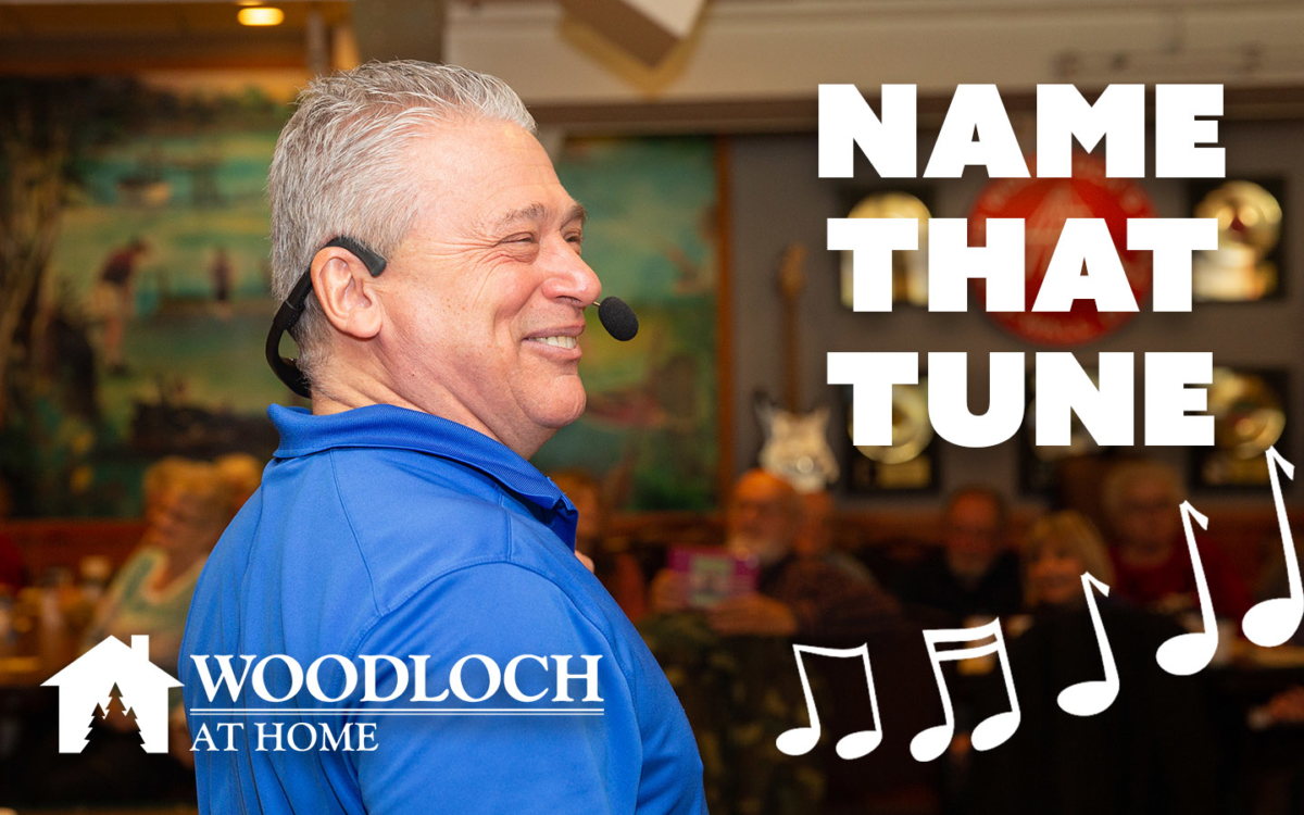 Woodloch employee with headset. Text: Name that tune, Woodloch at home.